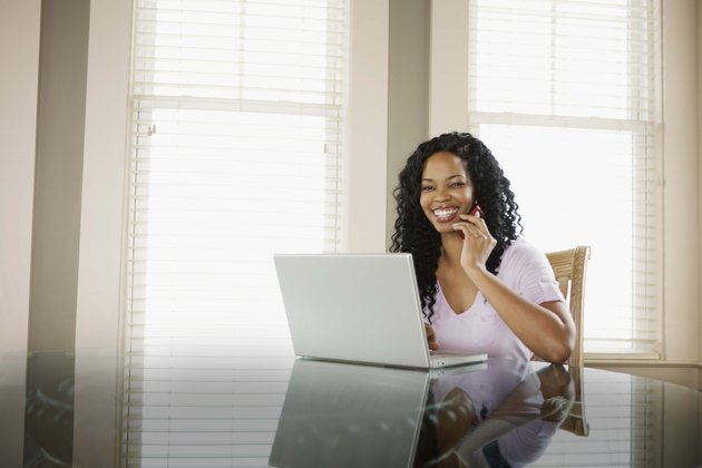 Woman on cell phone and laptop