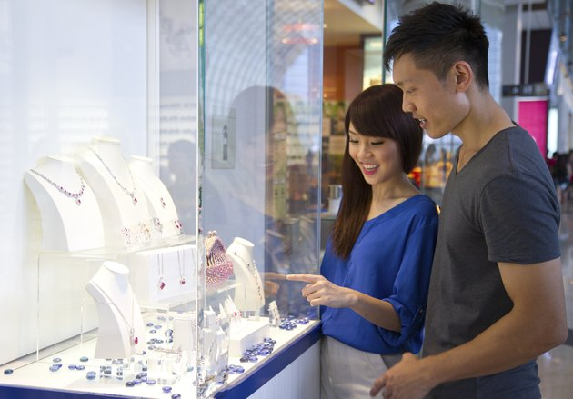 Attractive asian couple shopping in a retail mall
