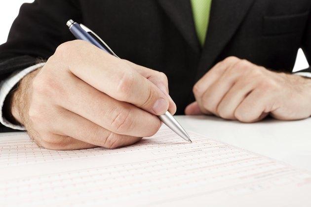 Businessman fills out a form.