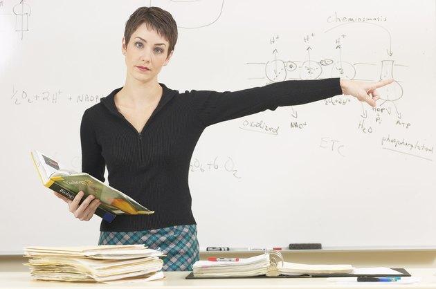 Science teacher pointing away