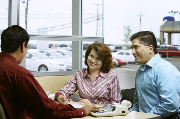 Couple negotiating car deal
