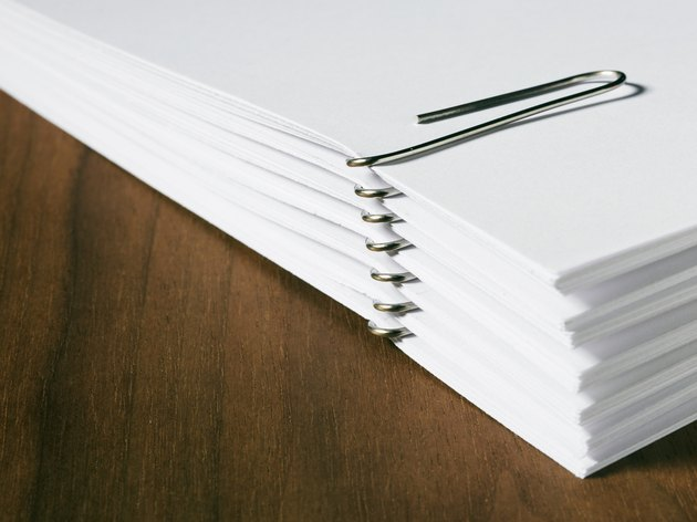 Stack of white papers with paper clips