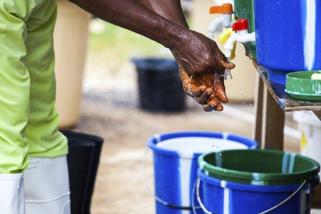 West African Nurse Washing Hands
