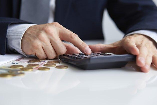 Men's hands with calculator