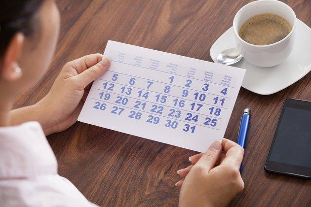 Businesswoman Marking In Calendar