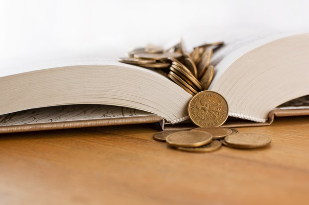 Open book with copper coins