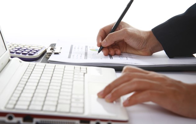 Business woman analyzing financial data