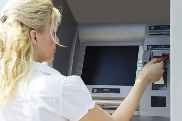 Businesswoman withdrawing money