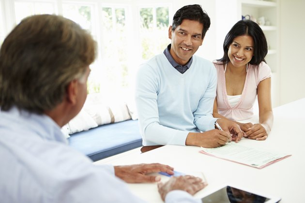 Indian Couple Meeting With Financial Advisor At Home