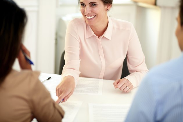 Female bank manager working on agreement contract