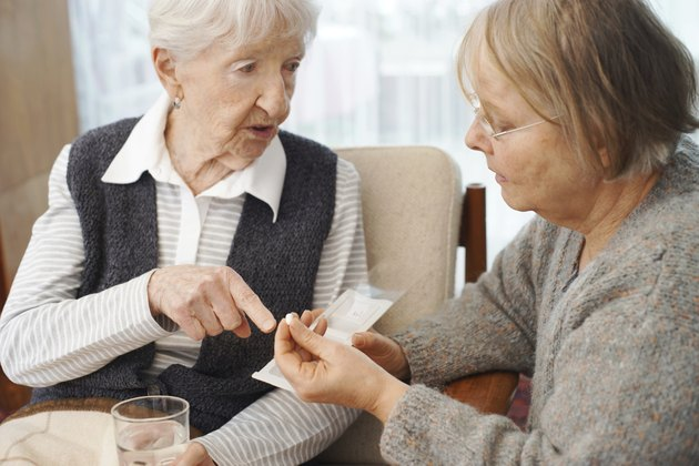 Elderly Patient discussing medication with a caretaker