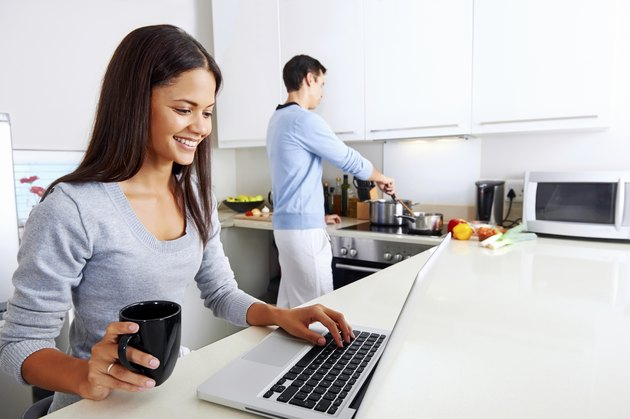 laptop kitchen couple