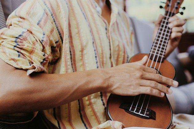 Closeup man playing ukulele