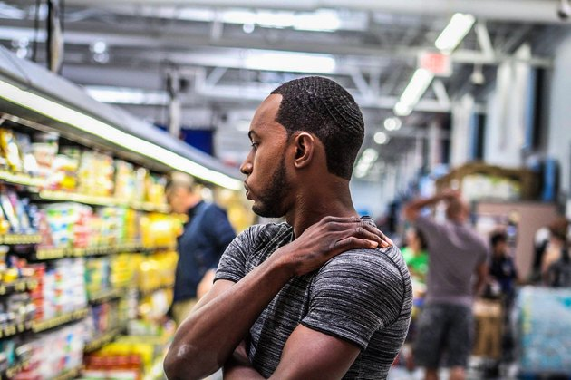 Young Black man in grocery store aisle
