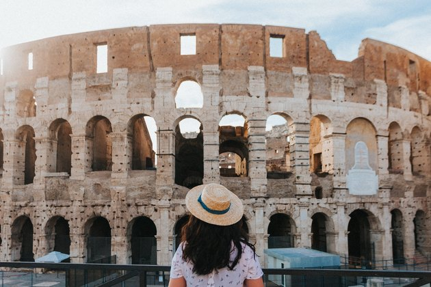 Young woman looking at the Colosseum