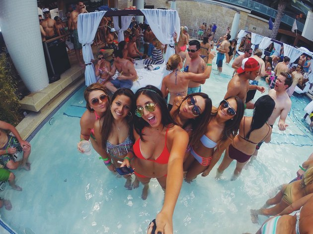 Partygoers at Vegas pool using selfie stick