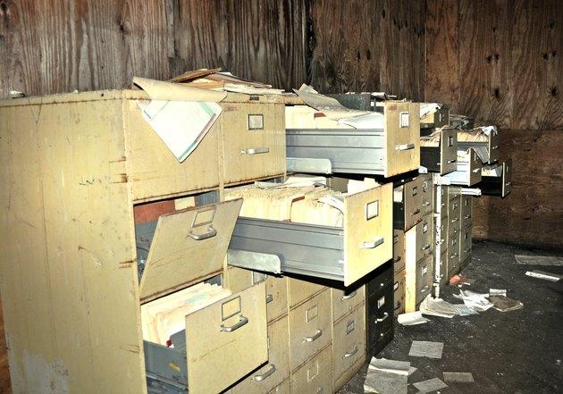 Abandoned and disheveled filing cabinets
