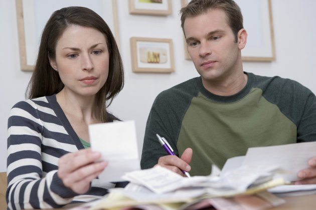 concerned couple looking at paperwork