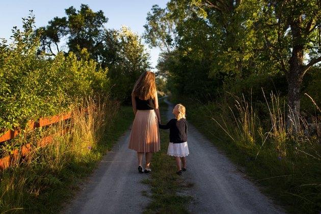 mother daughter walking woods