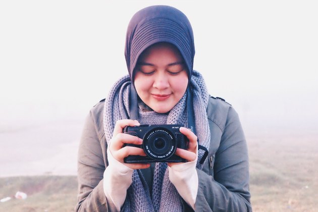 Woman in hijab taking a picture