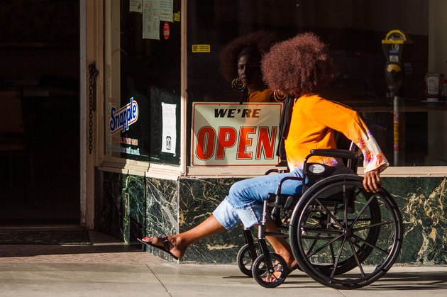 Black woman with Afro using wheelchair