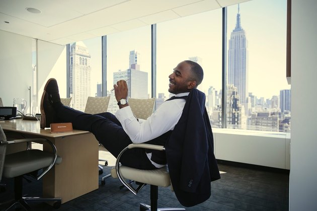 Dapper young Black man in fancy office