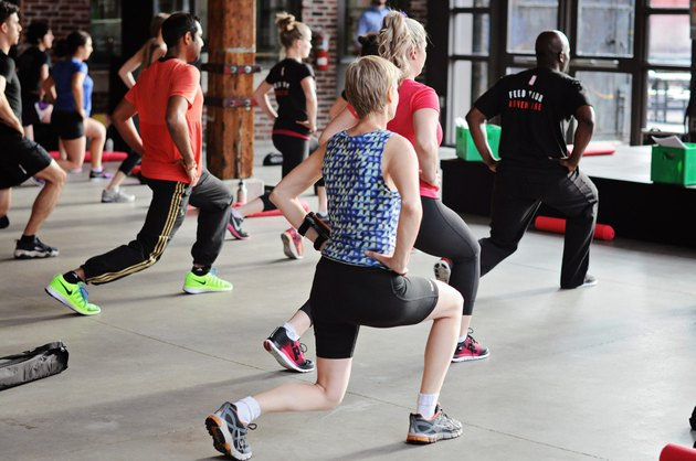 Group fitness class doing lunges
