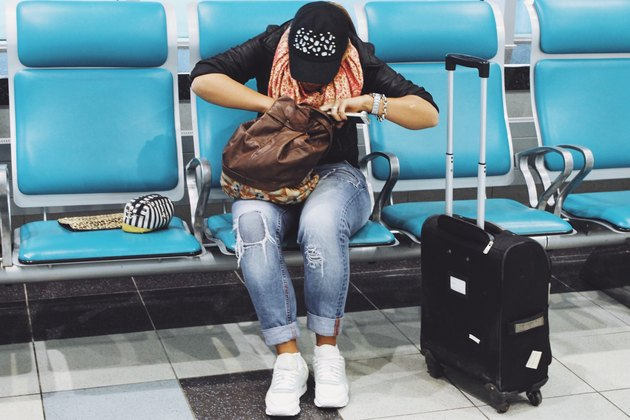 Woman in airport gate rummages through purse