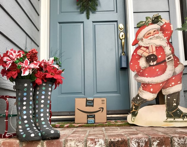 Amazon Prime package on holiday-festive front step