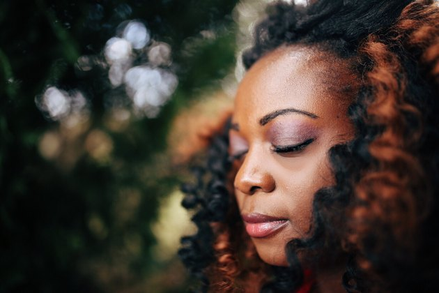 Portrait Black woman eyes closed meditating