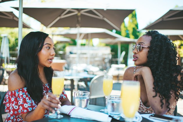 Two women with mimosas at brunch