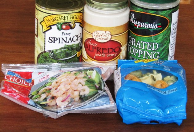 can of spinach, jar of alfredo sauce, jar of grated parmesan topping, package of frozen shrimp, package of dried tortellini