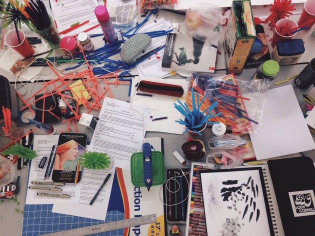 Messy table covered in art supplies