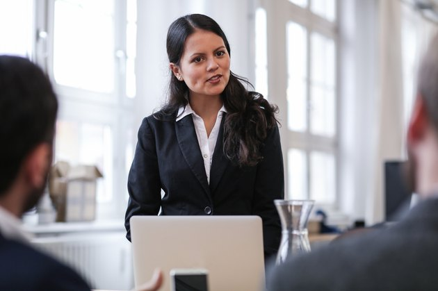 Woman in business suit giving presentation