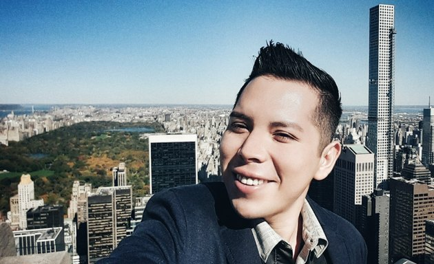 Selfie from high rise in business suit over Central Park