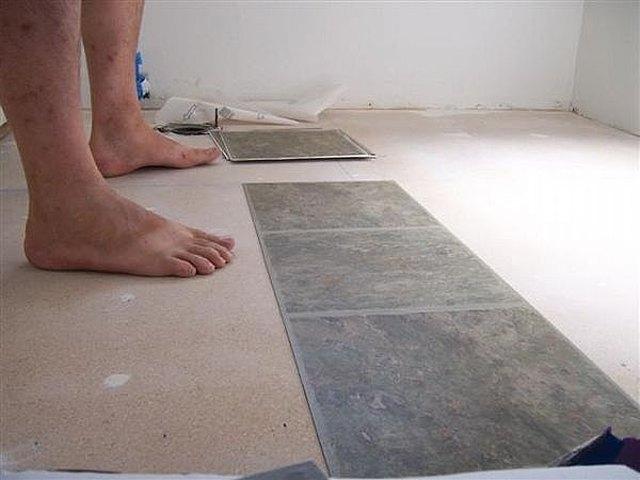 how to fix bathroom floor tiles