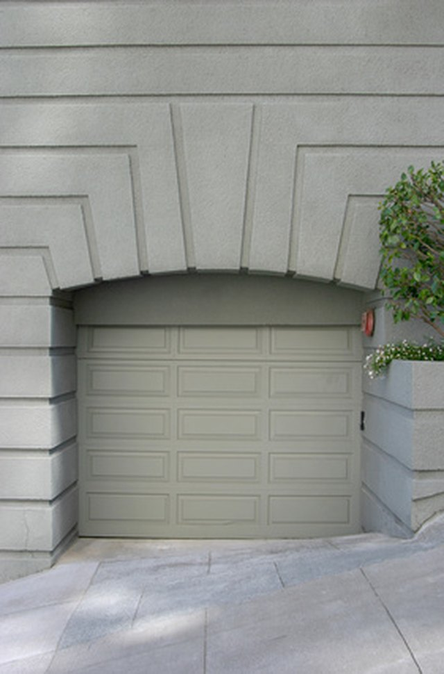 What Is a Tuck-under Garage? | Sapling.com What Is A Garage on what a farm, what a tv, what a tools, what a gazebo, what a loft, what a bar, what a car, what a hotel, what a spa, what a punk, what a pop, what a country, what a garden, what a den, what a kitchen, what a foyer, what a balcony, what a drama,
